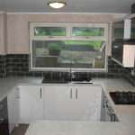 Aubergine Gloss Glacier White Doors Worktops Black