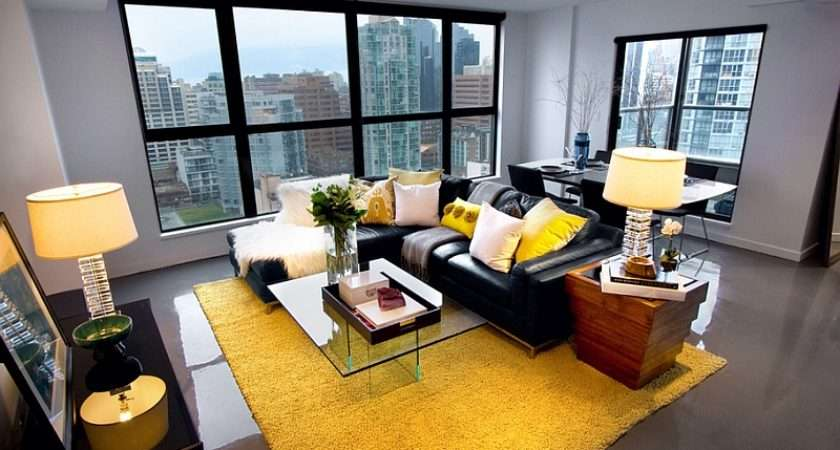 Black Couch Adds Visual Punch Living Room Yellow Grey