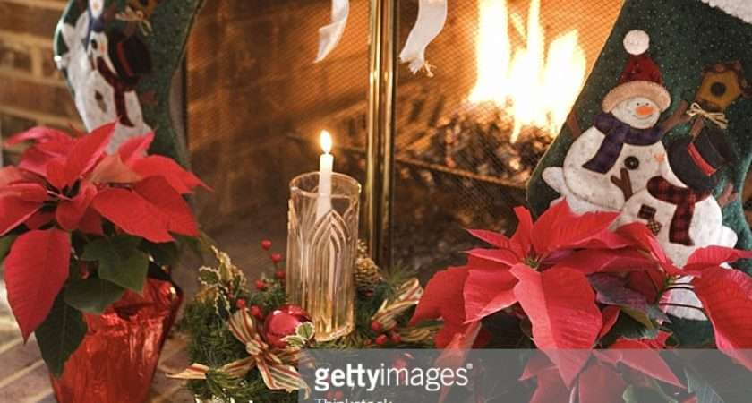 Christmas Stockings Over Fireplace Getty