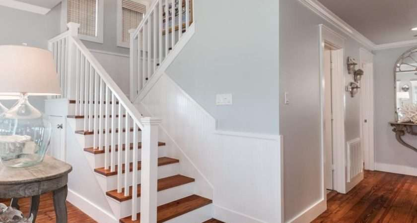 Cottage Staircase High Ceiling Hardwood Floors