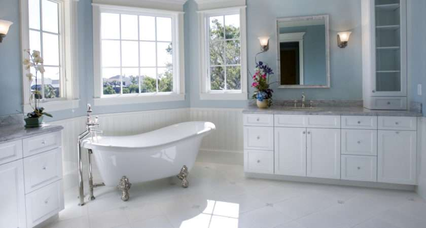 Float Above White Cabinetry Marble Flooring Bathroom