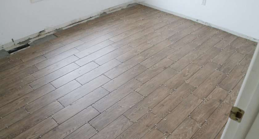 Help Few Friends Started Laying Our Faux Wood Tile Floors