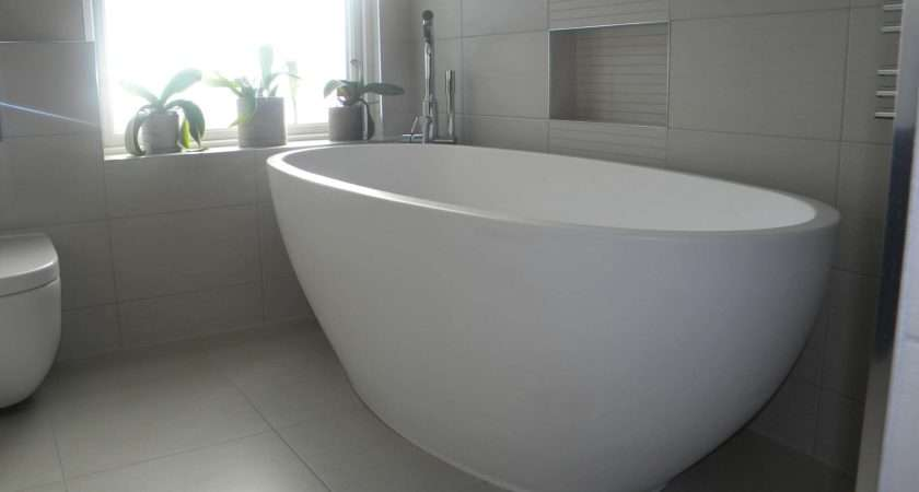 Marvelous Small Standing Bath Tubs Design Using White Color Style