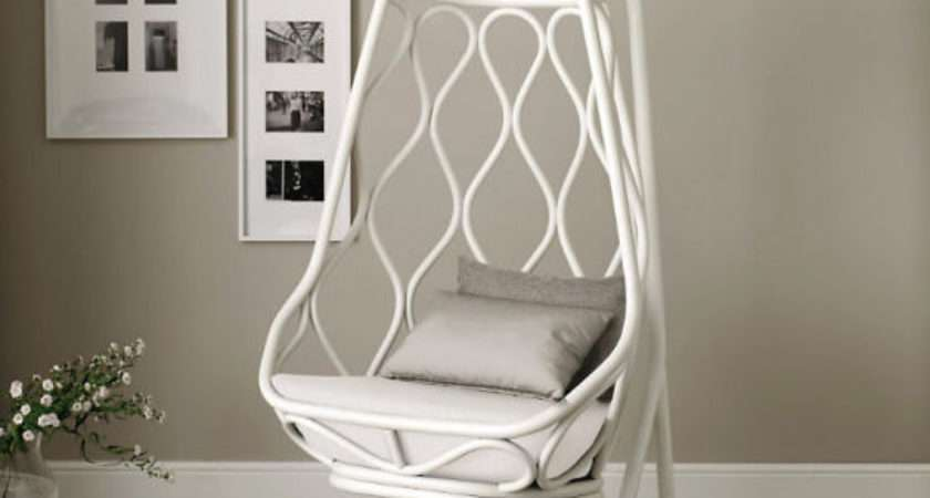 Nautica Hanging Chair Pale Stained Rattan Against Grey Wall