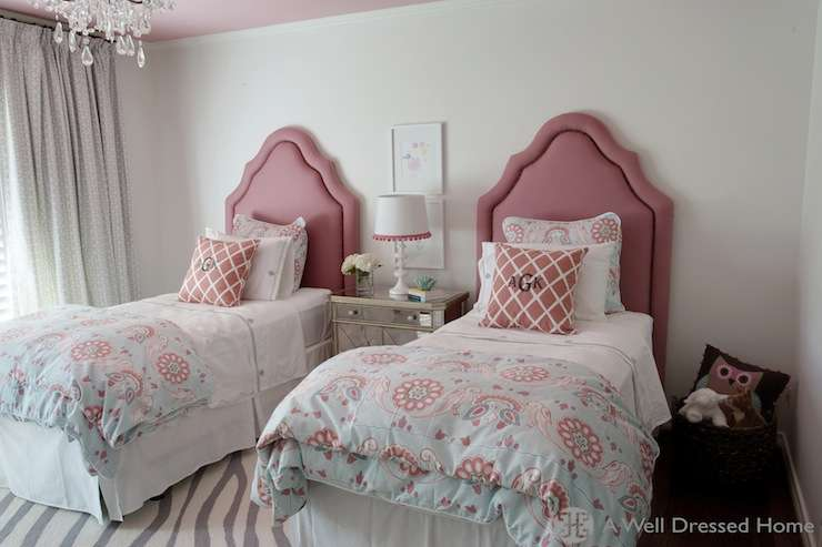Pink Headboards Accented Blue Bedding Flanking Shared
