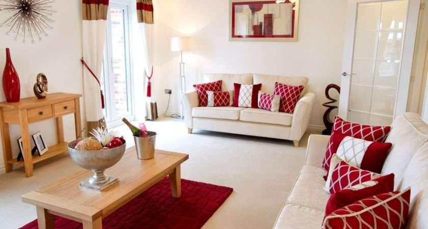 Red Hues Complement Welcoming Cream Interior Living Room