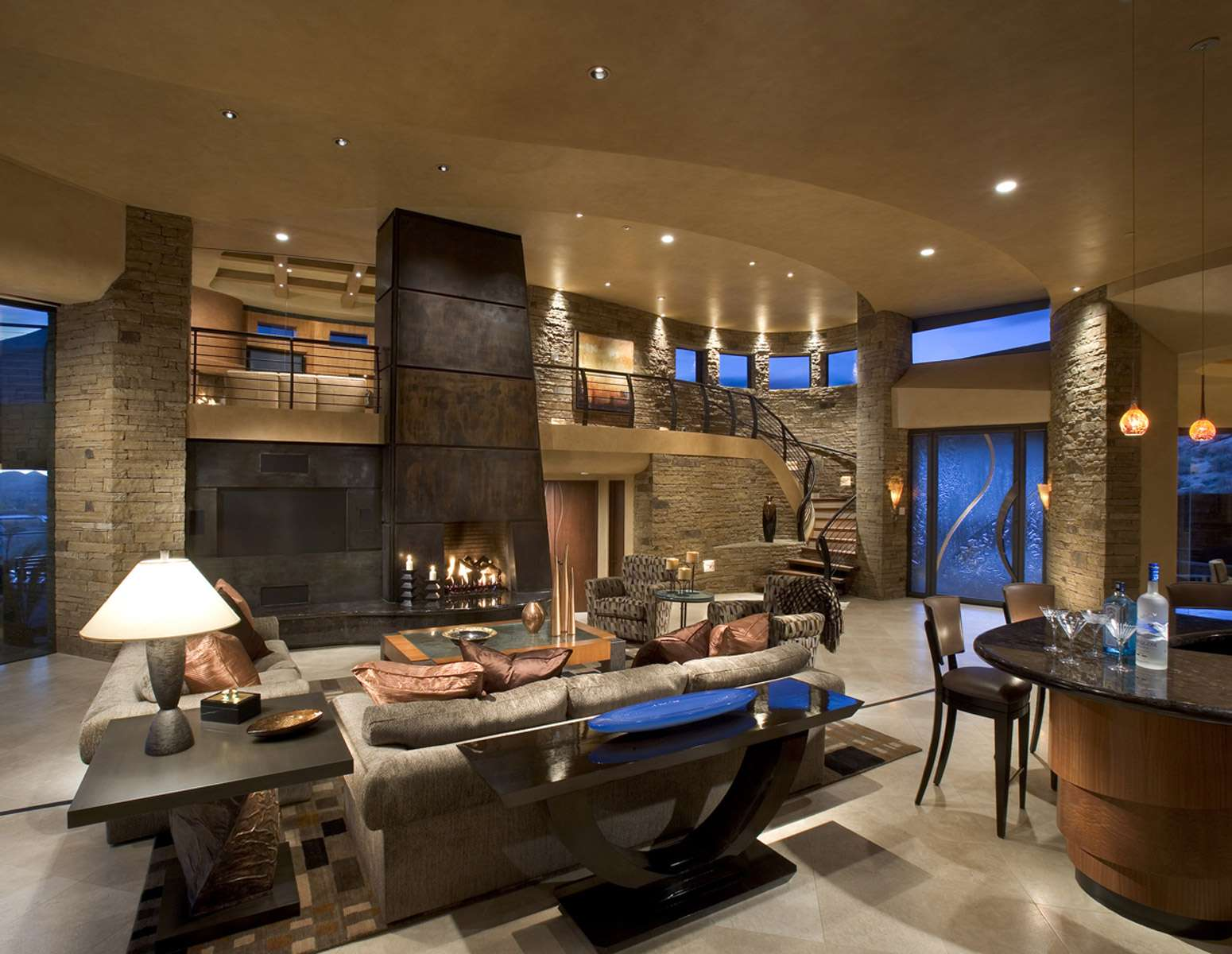 Sleek Flowing Contemporary Home Hugs Desert Floor Blending