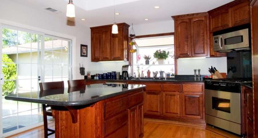 Small Appliances May Stored Underneath Kitchen Island