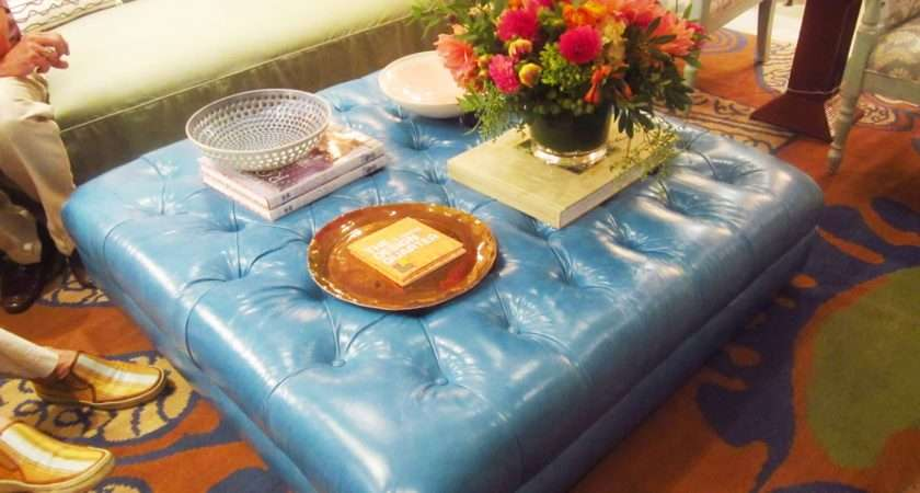 Turquoise Leather Square Ottoman Being Used Coffeetable