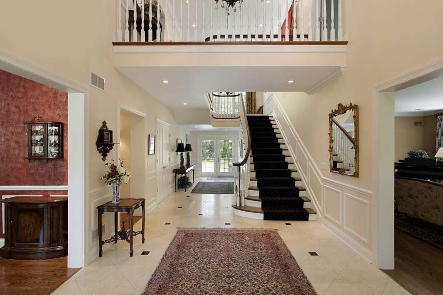 Two Story Modern Home Entrance Foyer Wood Floor Straight